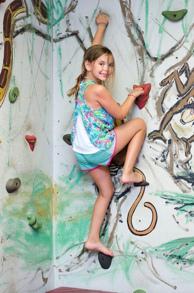 Girl climbing on RockQuest wall